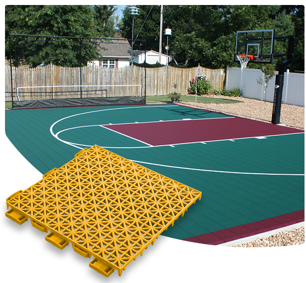 Versacourt Game Outdoor Tile - sample tile in foreground, example application at outdoor basketball court in background