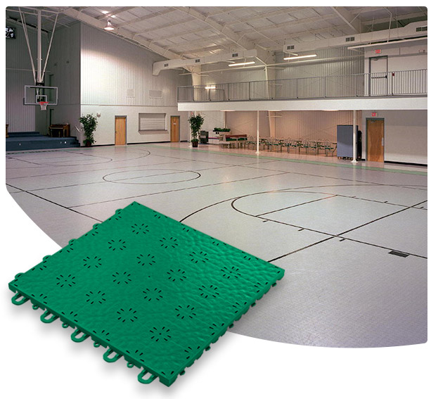 Versacourt Compete Tile green sample tile in foreground, example application at indoor basketball court in background