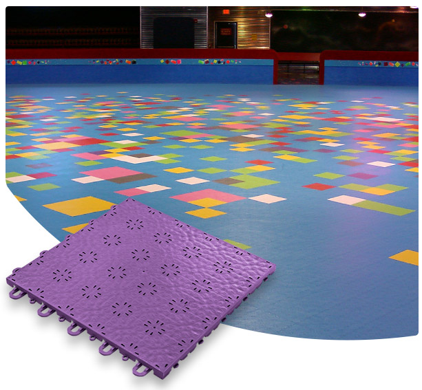Versacourt Skate Tile purple sample tile in foreground, example application at indoor skating rink in background