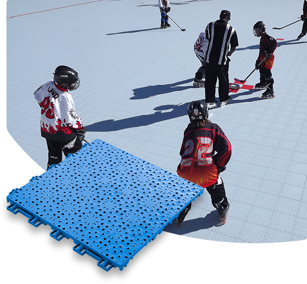 VersaCourt Speed Outdoor Tile blue sample tile in foreground, children playing inline hockey on Speed Outdoor tile in background