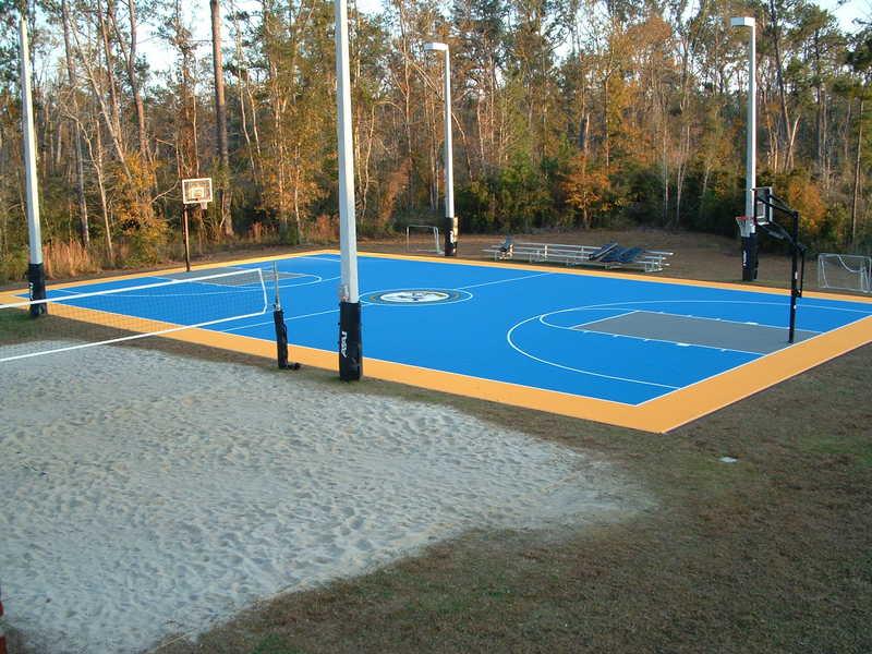 Versacourt commercial indoor outdoor backyard for Homemade indoor basketball court